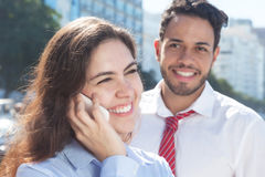 Happy business team with phone in the city Stock Images