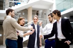 Business team playing rock paper scissors at modern office Royalty Free Stock Photography