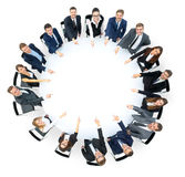 Happy business team pointing at something Royalty Free Stock Photos