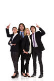 Happy business team pointing up Stock Photo