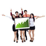 Happy business team showing a growing graph. Isolated on white background Royalty Free Stock Photography