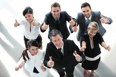 View from the top. happy business team showing thumb up. Royalty Free Stock Photography