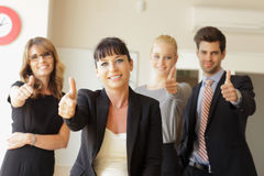 Happy business team showing thumbs up Stock Image