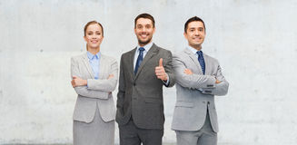 Happy business team showing thumbs up. Business, people, teamwork, success and gesture concept - happy team showing thumbs up Stock Images