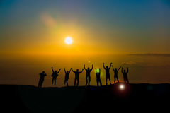 Happy business team silhouette  sunrise Stock Images