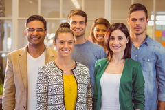 Happy business team smiling at camera Stock Images