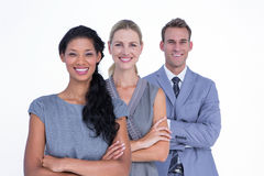 Happy business team smiling at camera stock image