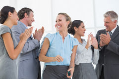 Happy business team smiling at each other. In the office Royalty Free Stock Image