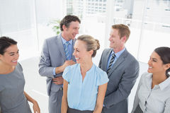 Happy business team smiling at each other Stock Image