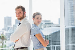 Happy business team standing back to back Stock Photography