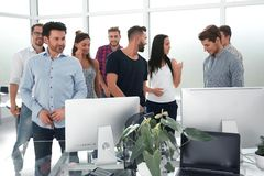 Happy business team standing in modern office stock photo