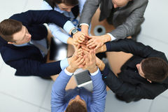 Happy business team. Success and winning concept - happy business team giving high five in office. top view Royalty Free Stock Images