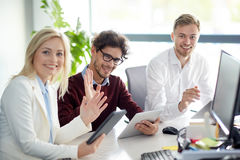 Happy business team with tablet pc at office Stock Image