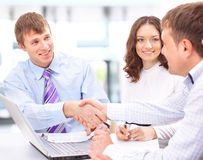 Happy business team talking Stock Photo