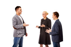 Happy business team talking together.  Royalty Free Stock Image