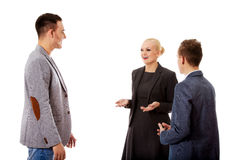 Happy business team talking together.  Royalty Free Stock Images