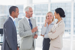 Happy business team talking. Together in the office Royalty Free Stock Images