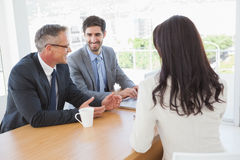 Happy business team talking together Royalty Free Stock Photos