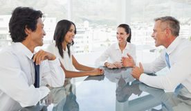 Happy business team talking together Royalty Free Stock Photo
