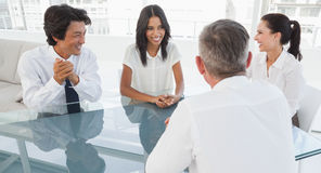 Happy business team talking together Stock Photography