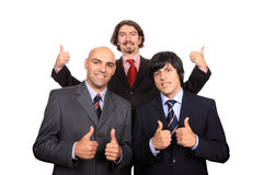Happy business team with thumbs up. Isolated on white - studio shot session Stock Photography