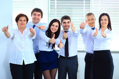 Happy business team with thumbs. Up in the office Stock Image