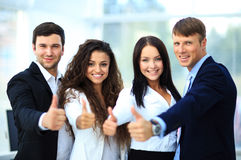 Happy business team with thumbs Stock Photography