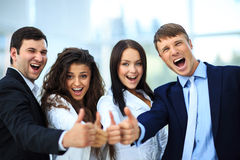 Happy business team with thumbs Royalty Free Stock Image