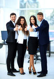 Happy business team with thumbs up in Royalty Free Stock Photos