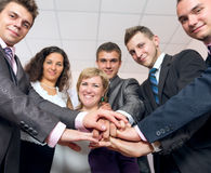Happy Business Team uniting Hands and smiling Royalty Free Stock Images