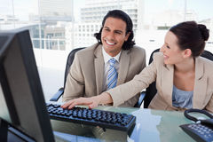 Happy business team using a computer Royalty Free Stock Images