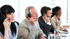 Happy business team using headsets Royalty Free Stock Photography