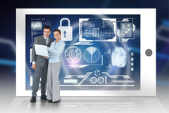 Happy business team using laptop with security interface Stock Photography