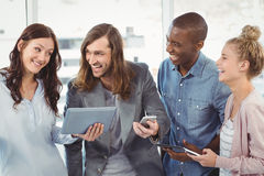 Happy business team using technology Royalty Free Stock Images