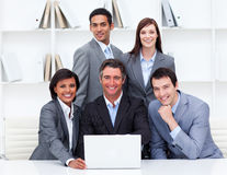 Happy business team working at a computer Royalty Free Stock Images