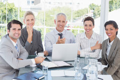 Happy business team working at desk together Royalty Free Stock Photos