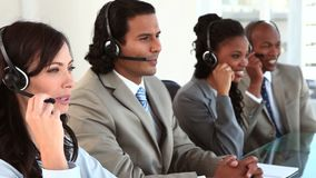 Happy business team working with headsets Stock Image