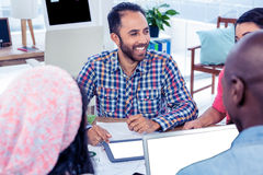 Happy business team working in office Stock Photos