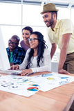 Happy business team working over computer Stock Image