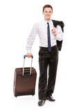 Happy business traveler carrying his luggage Stock Photography