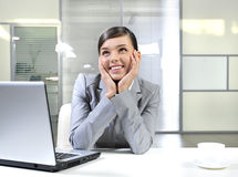 Happy business woman. Smiling in office with laptop royalty free stock photography