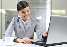 Happy business woman. Smiling in office with laptop stock photo