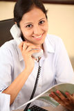 Happy business woman. Smiling Indian business woman talking on telephone Stock Images