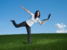 Happy business woman. Female with a laptop on one leg royalty free stock photo