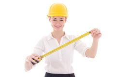Happy business woman architect in yellow builder helmet measurin Royalty Free Stock Photography