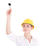 Happy business woman architect in yellow builder helmet painting Royalty Free Stock Photography