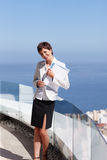 Happy business woman at the balcony holding files Royalty Free Stock Photography