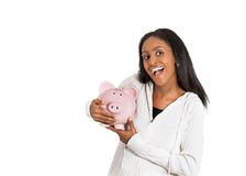 Happy business woman, bank employee holding piggy bank Royalty Free Stock Photo