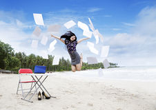 Happy business woman on beach Royalty Free Stock Images