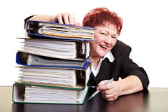 Happy business woman behind files Royalty Free Stock Photo